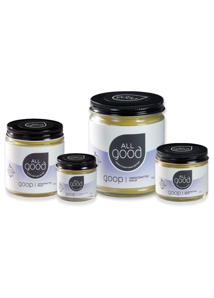 4 All Good Goop products in differing sizes with drop shadow shown on a white background.