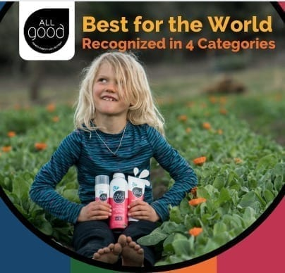 girl sitting in calendula garden with 3 All Good kid's sunscreen products in her lap