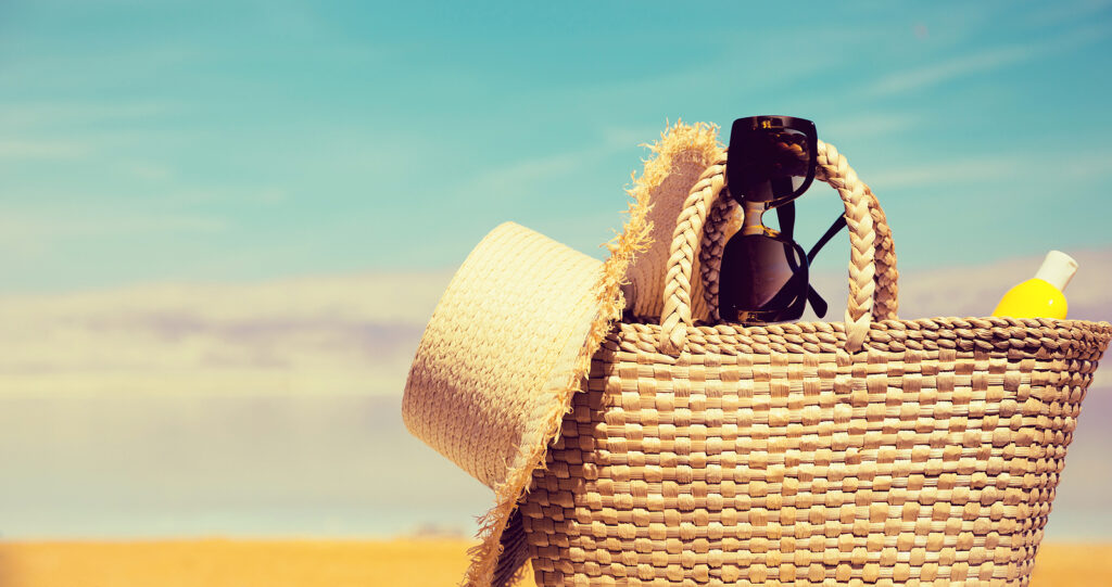 A photo of a beach bag with physical sunscreen, not chemical sunscreen, providing the benefit of uv filters